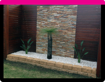 Sitting behind is a cultured-stone cladding wall. The rest of the fence is  made from merbau decking